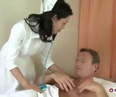 Japanese Nurse Takes 2 Cocks..